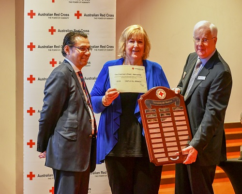President of Castle Hill Red Cross, Donna Fraser receives the Chairman's Shield from Sam Hardjono, (left) Chair, NSW Divisional Advisory Board and Ross Pinney (right) National President, Australian Red Cross
